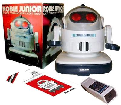Robie Jr, Tomy Robots; These Robots are great. His eyes shine as he moves, the right eye shines when he turns right and the left one lights when he moves left. Press down either arm to have him talk. If he runs into something he changes direction. Pushing his bumper also makes him speak.